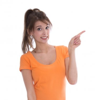 Surprised isolated young woman presenting with her finger.