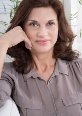 Portrait: Smiling attractive middle aged woman.