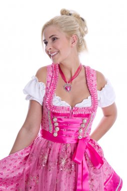 Pretty isolated young woman wearing bavarian dress called dirndl