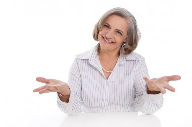 Happy isolated senior business woman over white presenting.