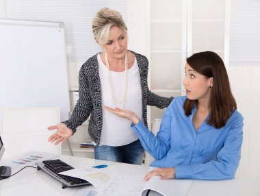 Business woman having problems at work: bullying, mobbing, heras