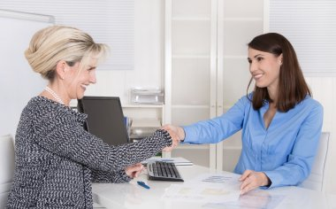 Successful woman business team or handshake in a job interview.