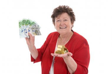 Isolated senior woman with money and gold: concept for pension a