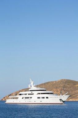 Luxury big mega motor yacht in the blue sea.