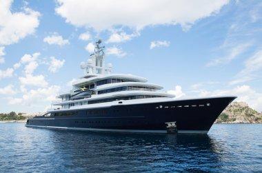 Gigantic big and large luxury mega yacht with helicopter landing