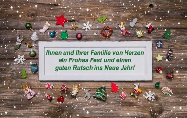 Christmas card with colorful decoration and german text merry ch