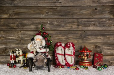 Nostalgic wooden christmas decoration with old children toys on
