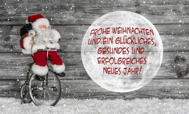 Merry christmas card in red and white with german text and a san