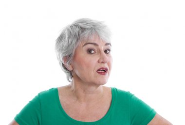 Isolated disappointed mature woman wearing green shirt looking a