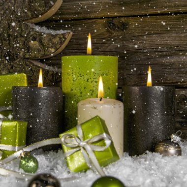 Decoration: four green and brown burning advent candles for chri