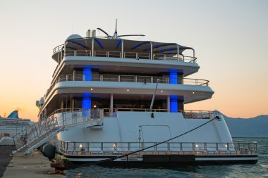 Sunset: Luxury large super or mega motor yacht in the evening.
