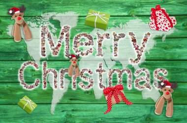 Merry christmas greetings with text on green wooden background -