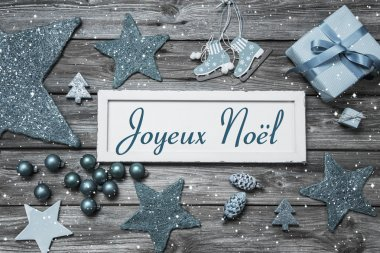 Merry Christmas card in blue and white with french text on woode