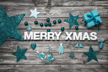 Merry christmas letters in white with turquoise decoration for a