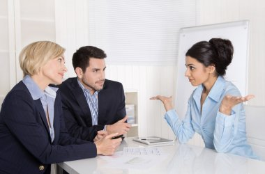 Job interview or business meeting: man and woman sitting at the