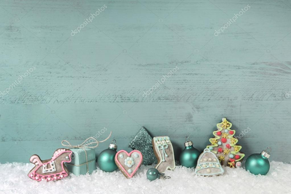 Shabby chic christmas decoration in turquoise on wooden backgrou
