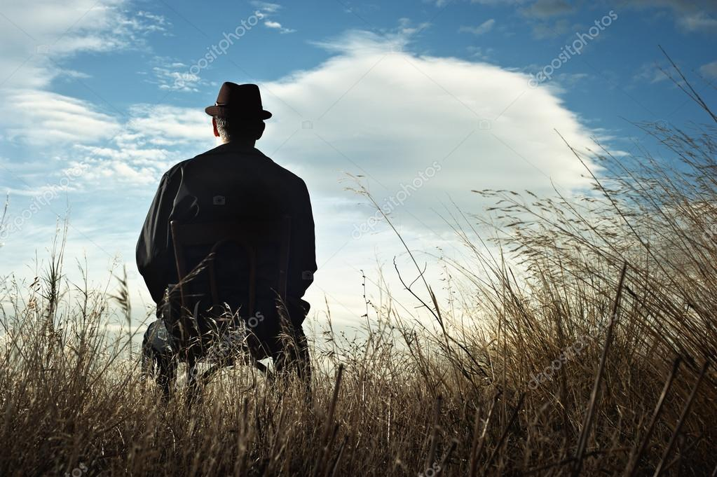 Man sitting on a chair in the countryside