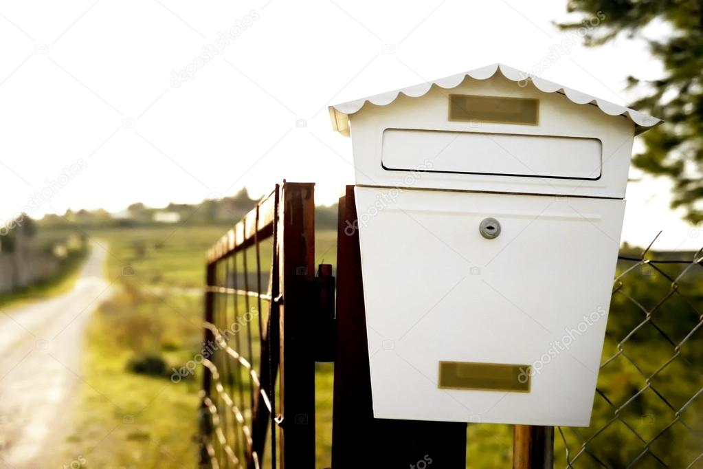 Mailbox on a fence