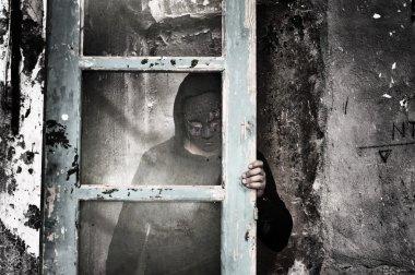 Man behind dirty glass