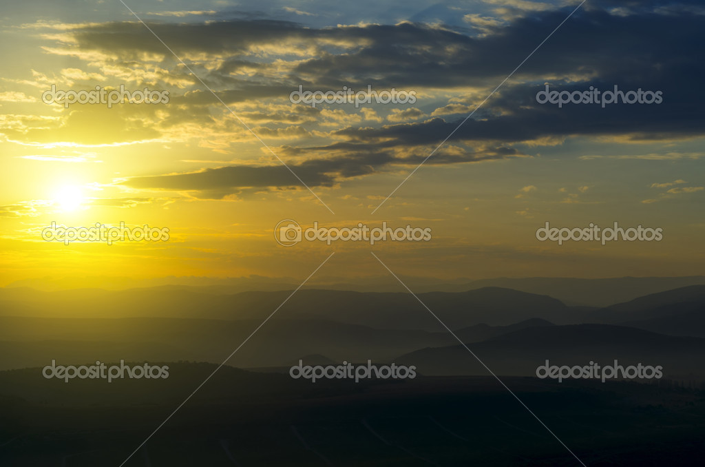 Beautiful sunset, casts a shadow of the majestic mountain ranges