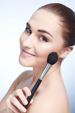 Beauty Girl with Makeup Brushes. Natural Make-up for Brunette Wo