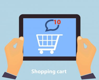 Hands holding Tablet PC screen showing on screen Shopping Cart Flat design Online Shopping concept and Computer Technology e-commerce concept in vector