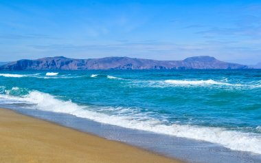 Sea cost with waves and sand, Crete, Greece