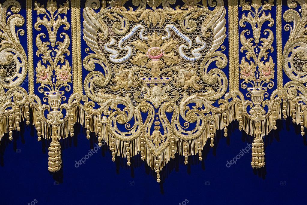 Embroidery Thread Of Gold On Blue Velvet Stock Photo