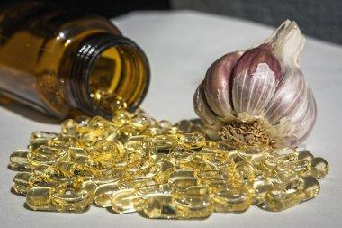 Garlic oil capsules, vitamins d pills