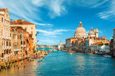 Fotografie Gorgeous view of the Grand Canal and Basilica Santa Maria della Salute during sunset with interesting clouds, Venice, Italy