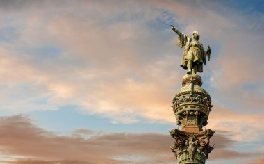 Monument of Christopher Columbus pointing towards America during golden sunset in Barcelona, Catalonia, Spain