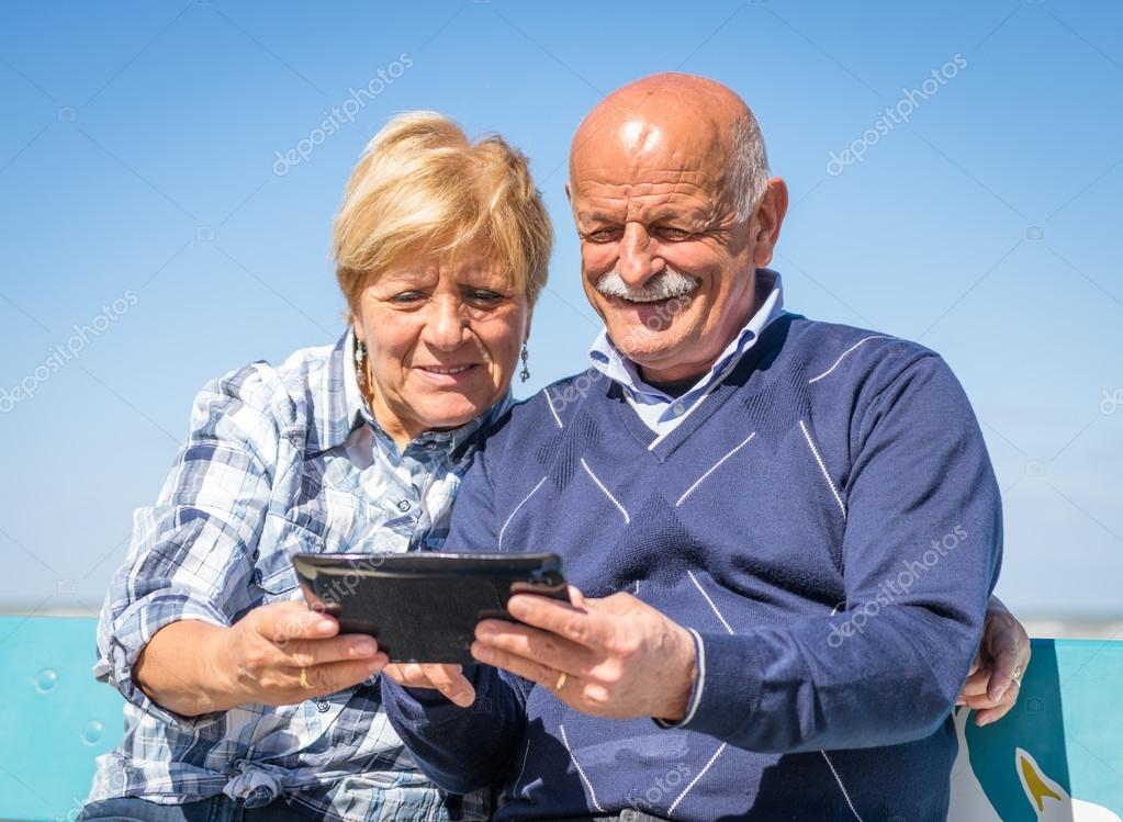 Old couple with tablet