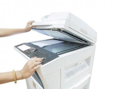 Hand holding copier machine