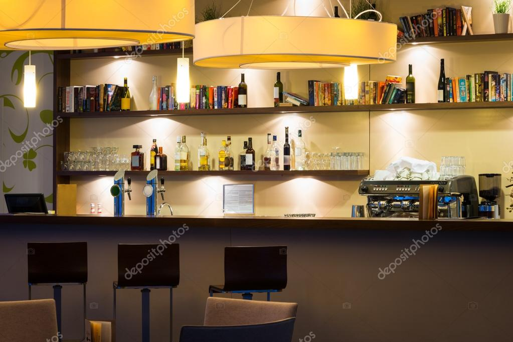 Nice hotel lounge bar with bottle shelfs and seats, tables, lights ...