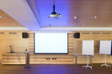 Blue reflections of video projector in wooden conference room