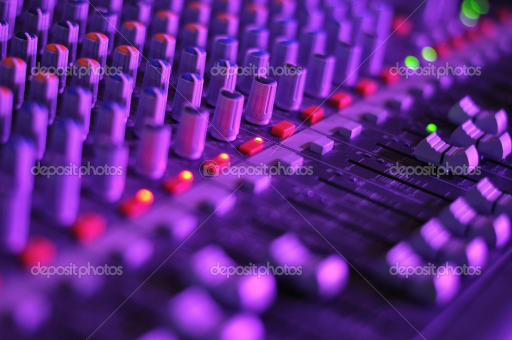 View of music mixer in concert, filled with lights
