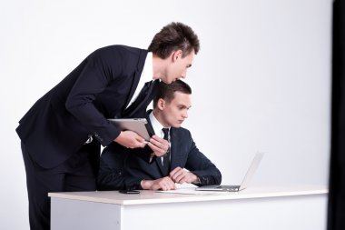 Businessmen  have conversation in office