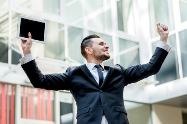 Incredible luck. Happy businessman celebrates his success. young