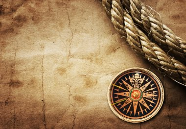 Old compass and rope on grunge background stock vector