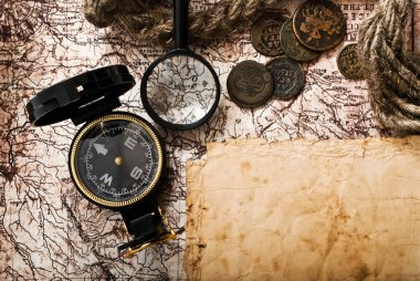 Old compass, coins and rope on grunge background stock vector