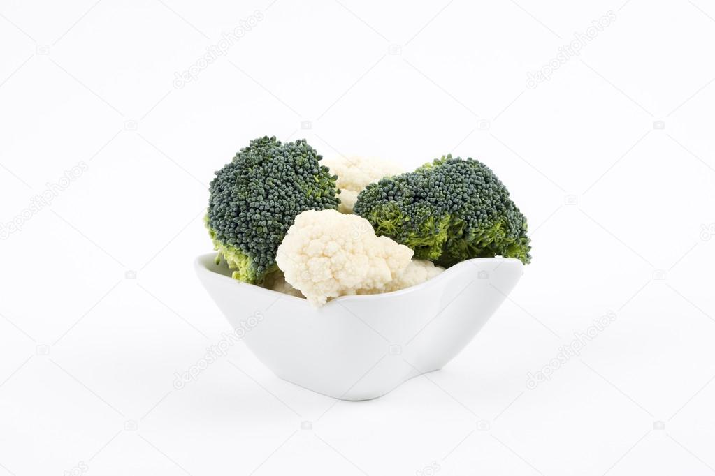 Broccoli and cauliflower in a porcelain bowl