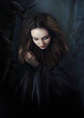 Dark woman. Vampire, witch
