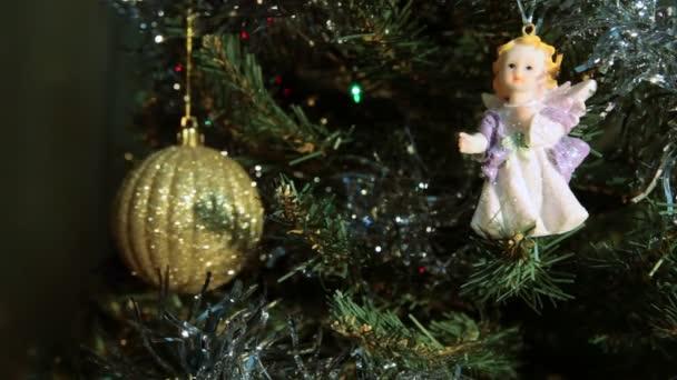 Christmas toys hanging on the Christmas tree