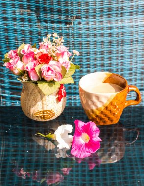 Still Life , Coffee Cup White Rose Plastic And Petunia flowers