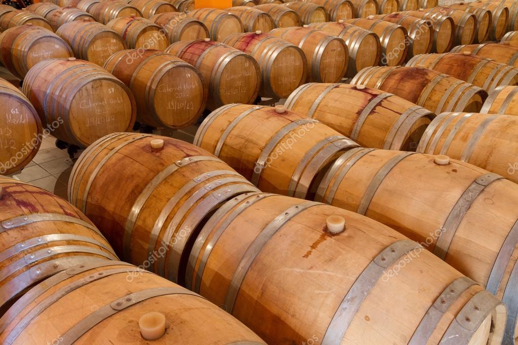Oak wine barrels Aged Wine Oak Wine Barrels In Winery Cellar Stock Photo Oak Wine Barrels In Winery Cellar Stock Photo Gpagomenos 35757911