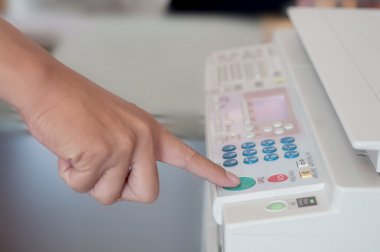 human hand press on start button
