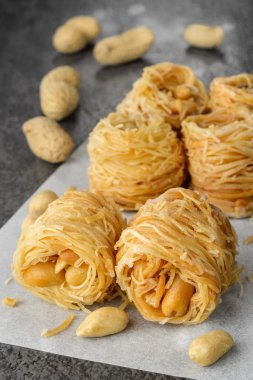 Closeup of birds nest baklava dessert with peanuts
