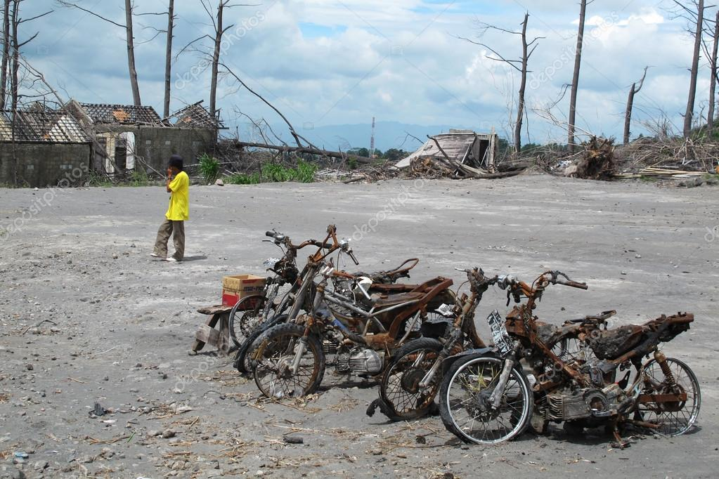 Burnt motorbike wrecks after volcano eruption