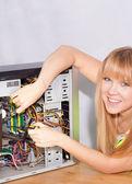 Fotografie lächelnd mädchen Reparatur computer