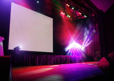 Stage in lights with blank big screen